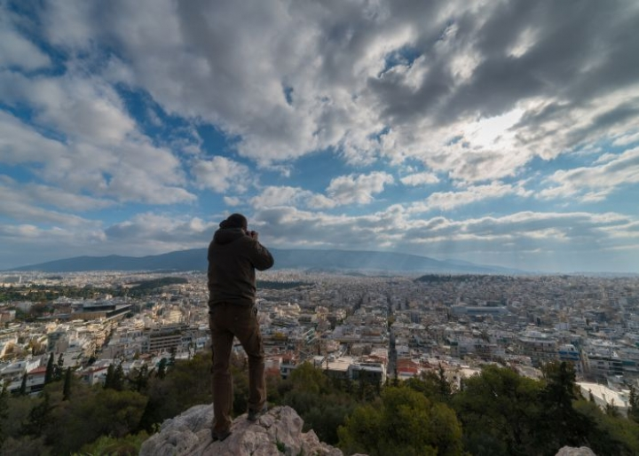 Photographer capturing a panoramic view of Athens - credits: KOSTAS-TSEK/Shutterstock.com
