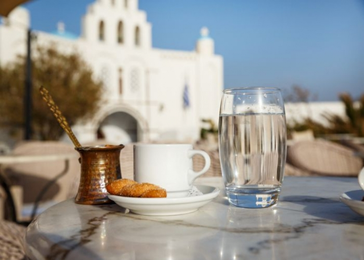 Greek coffee with a biscuit - credits: Santorines/Shutterstock.com