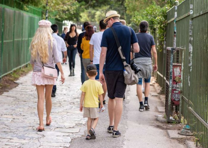 Family walking on Athens' streets towards the Acropolis- credits: Page Light Studios/Shutterstock.com